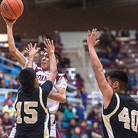 Ganado Hornet Tim Benally (10) attempts a jump shot over two Chinle guards Tuesday night in Ganado.