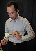 Dr. Daniel Latt, UA associate professor of orthopedic surgery and assistant professor of biomedical engineering, with an elbow joint. He worked with UA Engineering Design Program students on a system that aids elbow surgery patients in healing and regaining normal range of motion.