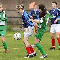 Rachel Kellegher Newmarket-on-Fergus & Abigail Connellan Connolly Celtic in a tussle for possession. - Photograph by Flann Howard