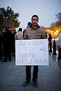 "Miguel Tavera, 18, shows his continued support of President Barack Obama on Wednesday, Nov. 7, 2012 in Washington, D.C. Tavera is originally from Broward County Florida and voted first time this year by absentee ballot. He and fellow students from George Washington University stood outside of the White House to catch a glimpse of the President as he returned to Washington from Chicago on Wednesday evening. Tavera said his sign indirectly translates ""power to the Hispanic vote."""