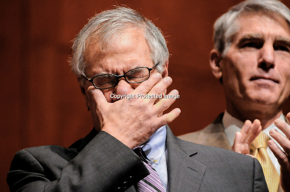 US Representative Barney Frank (D-MA) (L) wipes away tears as he arrives to watch House Speaker Nancy Pelosi sign the bill repealing the military's Don't Ask Don't Tell policy against gays to send to the White House to be enacted into law, at the U.S. Capitol in Washington, December 21, 2010. Also pictured is Senator Mark Udall (D-CO) (R). REUTERS/Jonathan Ernst (UNITED STATES - Tags: POLITICS MILITARY IMAGES OF THE DAY) - RTXVXQX