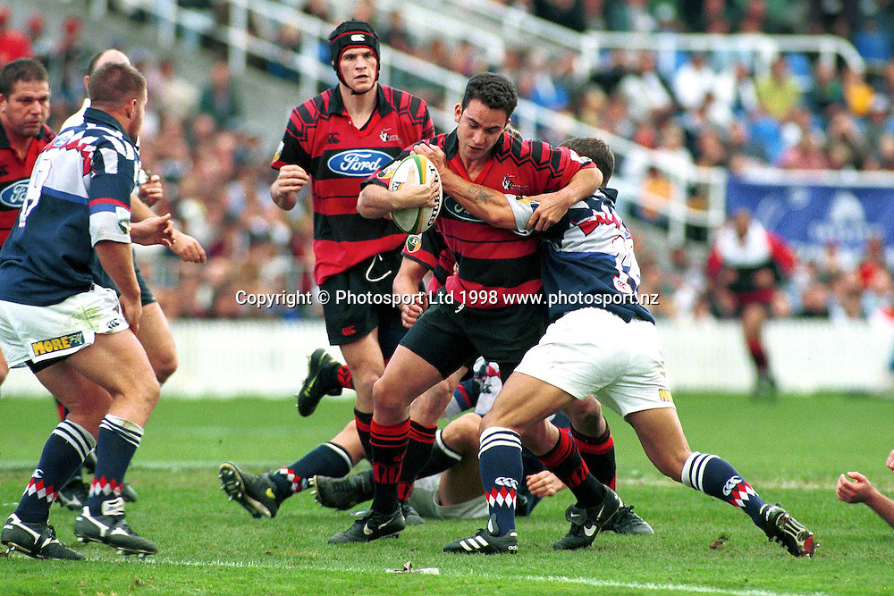 James Kerr is tackled, Canterbury Crusaders v Auckland Blues, Super 12 Rugby Union final, Eden Park, Auckland. Canterbury won 20-13. 30 May 1998. Photo: Scott Barbour/PHOTOSPORT
