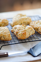 Apple and cheddar scones cooling on a wire cooling rack.