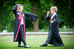 © Licensed to London News Pictures. 23/06/2017. Bolton UK. Grace Chapman age 7 & Jack Disley age 6 take part in a attempt to break the world record for the largest gathering of people dressed as Harry Potter that is taking place this morning at Smithhills Hall in Bolton. Bolton Museum & Library Services along with eleven local schools are coming together to try & break the record. Photo credit: Andrew McCaren/LNP