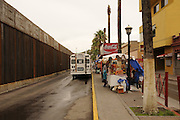 Locals walk the streets near the border wall in Nogales, Sonora, Mexico, located across the internation line from Nogales, Arizona, USA.