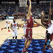 Ryan Manuel, (right), SMU, shoots over Quenton DeCosey, Temple, during the Temple Vs SMU Semi Final game at the American Athletic Conference Men's College Basketball Championships 2015 at the XL Center, Hartford, Connecticut, USA. 14th March 2015. Photo Tim Clayton