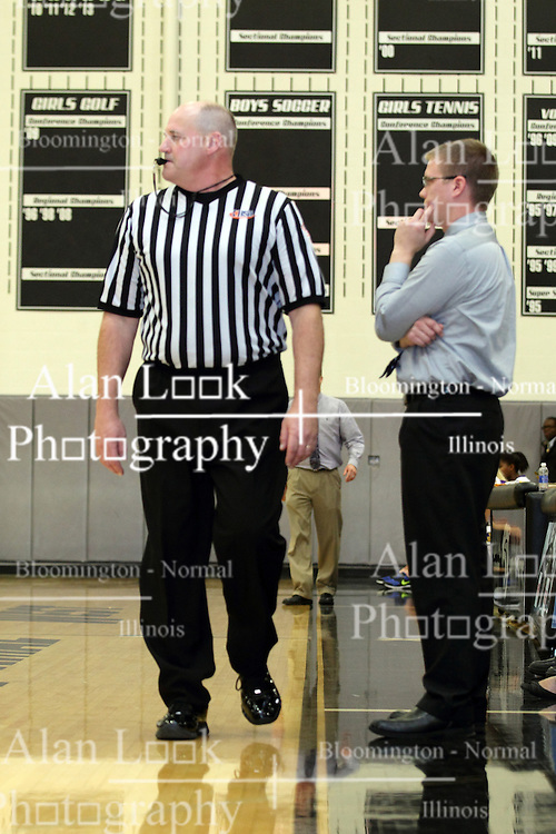 20 November 2015: kurt hartke walks the sideline near a coach while watching the action. Normal Community West Lady Wildcats v Bloomington Lady Raiders at Girls Intercity in the gym at Normal Community West in Normal IL