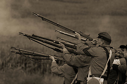 Confederate infantry troops firing at Union Home Guard in Civil War battle in 1863 at Corydon, Indiana