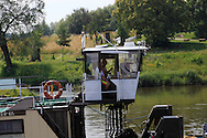 A barge driver blows  his horn on the Elbe River in Germany.<br /> Photo by Dennis Brack