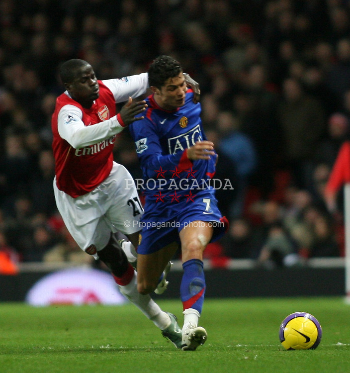 London, England - Sunday, January 21, 2007: Arsenal's Emmanuel Eboue and Manchester United's Cristiano Ronaldo during the Premier League match at the Emirates Stadium. (Pic by Chris Ratcliffe/Propaganda)