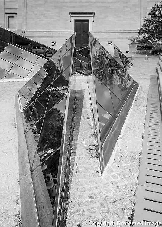 These skylights follow the triangular plan form of the I.M. Pei designed National Gallery West Wing and let light into the underground cafes and museum store.