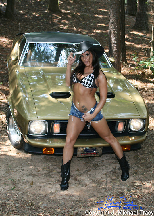 Gorgeous Cowgirl posing with gorgeous 1973 Ford Mustang Mach 1.