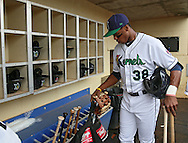 Kernels right fielder Adam Brett Walker II (38) stores his equipment before the start of a game between the Cedar Rapids Kernels and the Quad Cities River Bandits at Veterans Memorial Stadium in Cedar Rapids, Iowa on June 5, 2013.