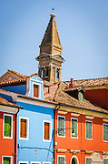 Leaning bell tower of San Martino church and houses, Burano, Veneto, Italy