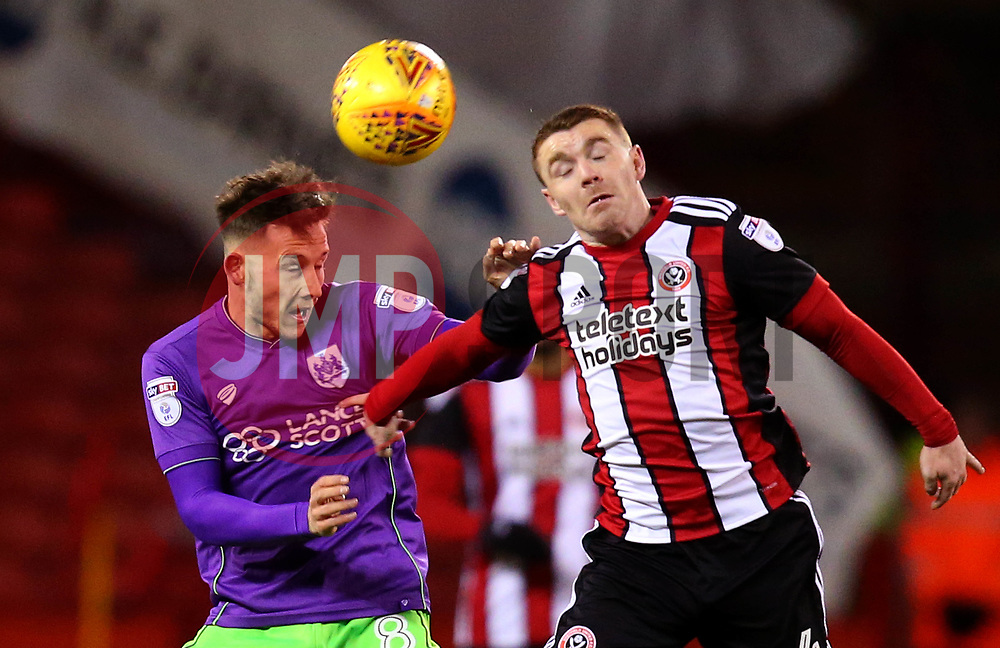 Josh Brownhill of Bristol City challenges John Fleck of Sheffield United to a header - Mandatory by-line: Robbie Stephenson/JMP - 08/12/2017 - FOOTBALL - Bramall Lane - Sheffield, England - Sheffield United v Bristol City - Sky Bet Championship