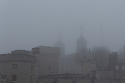 © Licensed to London News Pictures. 30/12/2016. LONDON, UK.  The Tower of London is shrouded in fog. London is experiencing more freezing and foggy weather this morning.  Photo credit: Vickie Flores/LNP