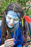 woman in a Costume of Neytiri (a Na'vi) from the 2009 Avatar film .