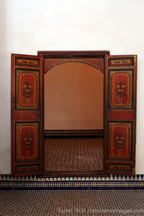 Africa, Morocco, Marrakech. Carved painted wood door at El Bahia Palace.