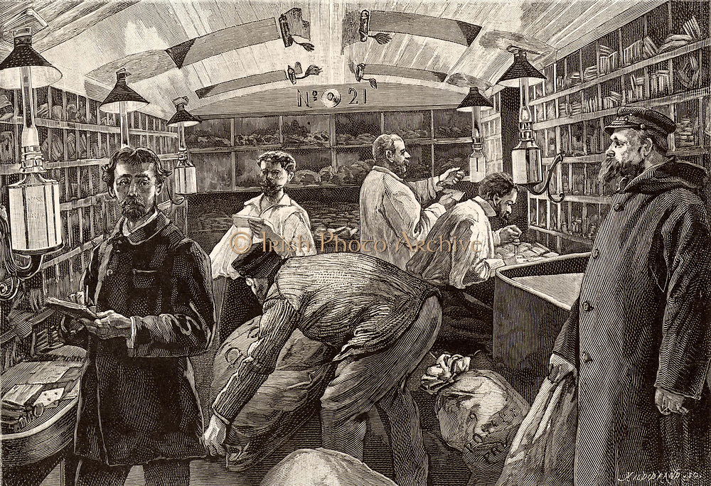 French postal service.  Sorting letters on the Paris-Marseilles express by the light of oil lamps.  The expansion of the railway network in the nineteenth century greatly improved mail services.  Dedicated overnight mail trains, or mail carriages attached to scheduled trains, enabled mail to be sorted en route to a distribution centre.    Engraving from 'Le Journal de la Jeunesse' (Paris, 1886).