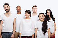 Portrait of multi-ethnic friends in white t-shirts standing together over white background