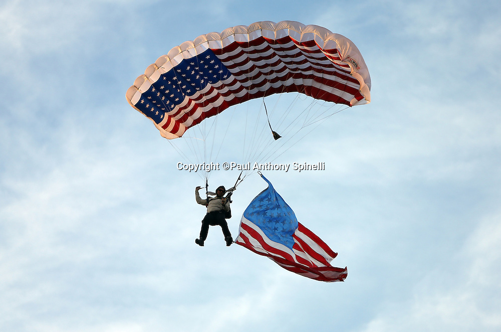 A member of the Frog-X parachute team does a parachute jump onto the field as part of Salute to the Military Week prior to the San Diego Chargers NFL week 4 preseason football game against the San Francisco 49ers on Thursday, Aug. 29, 2013 in San Diego. The 49ers won the game 41-6. ©Paul Anthony Spinelli