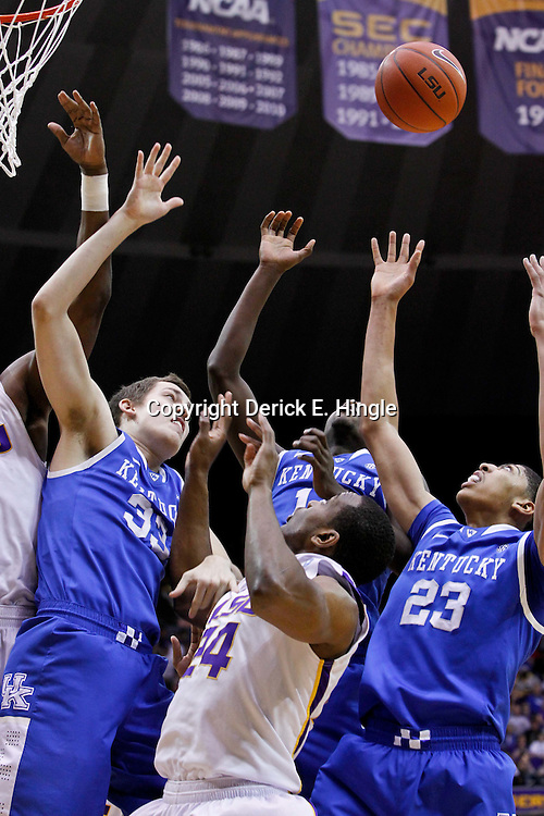 January 28, 2012; Baton Rouge, LA; LSU Tigers forward Malcolm White (5) and forward Storm Warren (24) battle for a rebound with Kentucky Wildcats forward Kyle Wiltjer (33), forward Michael Kidd-Gilchrist (14) and forward Anthony Davis (23) during the first half of a game at the Pete Maravich Assembly Center.  Mandatory Credit: Derick E. Hingle-US PRESSWIRE