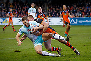 Widnes Vikings full back Rhys Hanbury (1) is tackled during the Betfred Super League match between Castleford Tigers and Widnes Vikings at the Jungle, Castleford, United Kingdom on 11 February 2018. Picture by Simon Davies.
