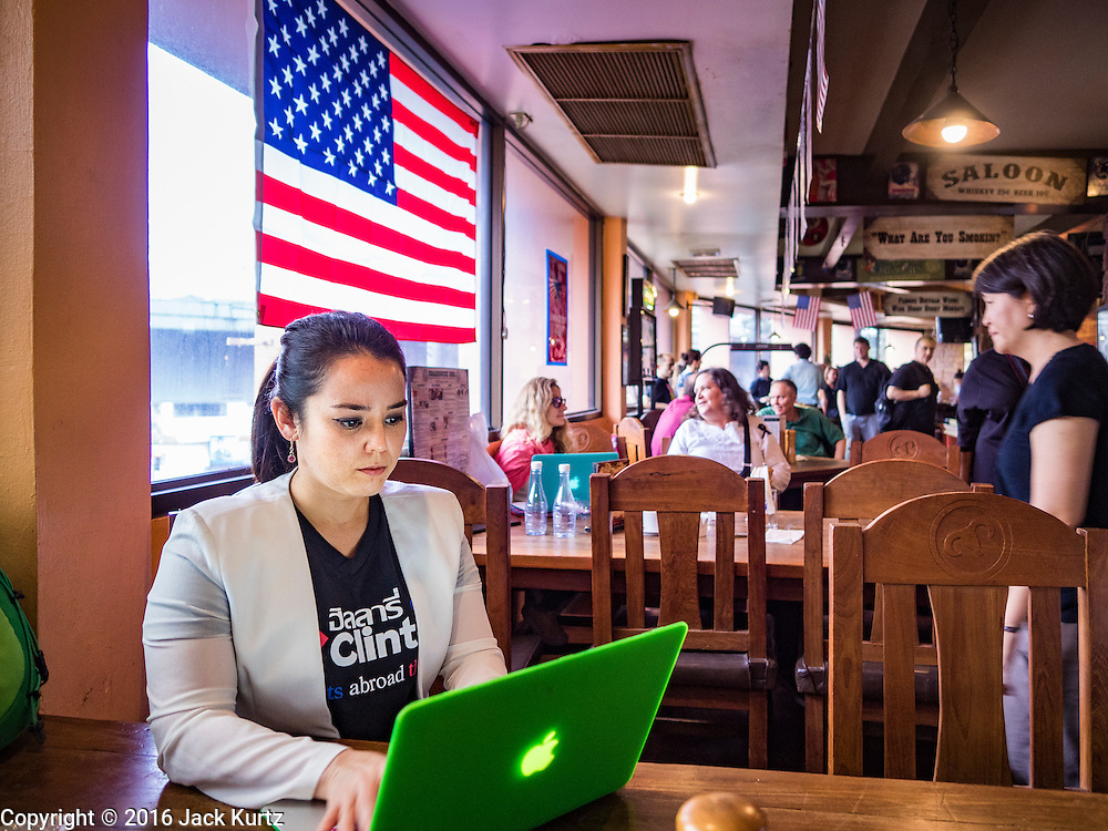 09 NOVEMBER 2016 - BANGKOK, THAILAND:   A woman watches US election results come in at the Democrats Abroad Thailand election watch party in Bangkok. Democrats Abroad Thailand met at the Roadhouse Barbecue, an American restaurant in Bangkok, to watch election results come in. It was a somber election watch party as what was expected to be a Clinton victory turned into a Trump win.    PHOTO BY JACK KURTZ