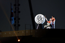 The final torch bearers light the Olympic flame during the opening ceremony of the PyeongChang 2018 Winter Paralympics at the PyeongChang Olympic Stadium in South Korea.