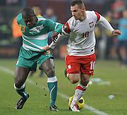 POZNAN 17/11/2010.FOOTBALL INTERNATIONAL FRIENDLY.POLAND v IVORY COAST.Ludovic Obraniak of Poland and Koffi Romaric Ndri of Ivory Coast ..Fot: Piotr Hawalej / WROFOTO