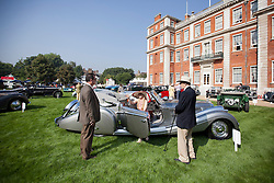 © Licensed to London News Pictures. 05/09/2013. London, UK. Classic automobile fans are seen with a Horch 853 Voll and Ruhrbeck Sport Cabriolet at the St James's Concours of Elegance classic car event at Royal Gardens of St James's Palace in London today (05/09/2013). The event, which alternates each year between Windsor Castle and St James's Palace, features sixty rare cars from across the world and takes place over the next three days. Photo credit: Matt Cetti-Roberts/LNP