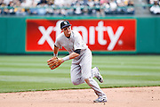 PITTSBURGH, PA - APRIL 7: Troy Tulowitzki #2 of the Colorado Rockies looks to field a ground ball backhanded during the game against the Pittsburgh Pirates at PNC Park on April 7, 2011 in Pittsburgh, Pennsylvania. The Rockies won 7-1. (Photo by Joe Robbins) *** Local Caption *** Troy Tulowitzki
