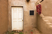 Chilis Hanging on Front Porch, Taos Pueblo, New Mexico