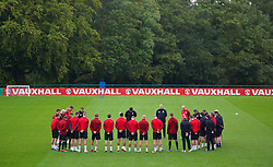 CARDIFF, WALES - Monday, October 14, 2013: The Wales squad stand for a minute's silence to mark the 100th anniversary of the  Senghenydd Colliery Tragedy and victims of all mining disasters, before a training session at the Vale of Glamorgan ahead of the 2014 FIFA World Cup Brazil Qualifying Group A match against Belgium. (Pic by David Rawcliffe/Propaganda)