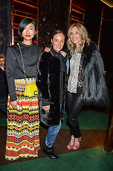 Left to right, MIMI XU, DANIELA AGNELLI and KIM HERSOV at a dinner hosted by Roger Vivier to celebrate The Prismick Denim by Camillle Seydoux held at Casa Cruz, 123 Clarendon Road, London on 17th March 2016.