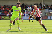 Ritchie Sutton and Danny Wright during the Vanarama National League match between Cheltenham Town and Tranmere Rovers at Whaddon Road, Cheltenham, England on 26 September 2015. Photo by Antony Thompson.