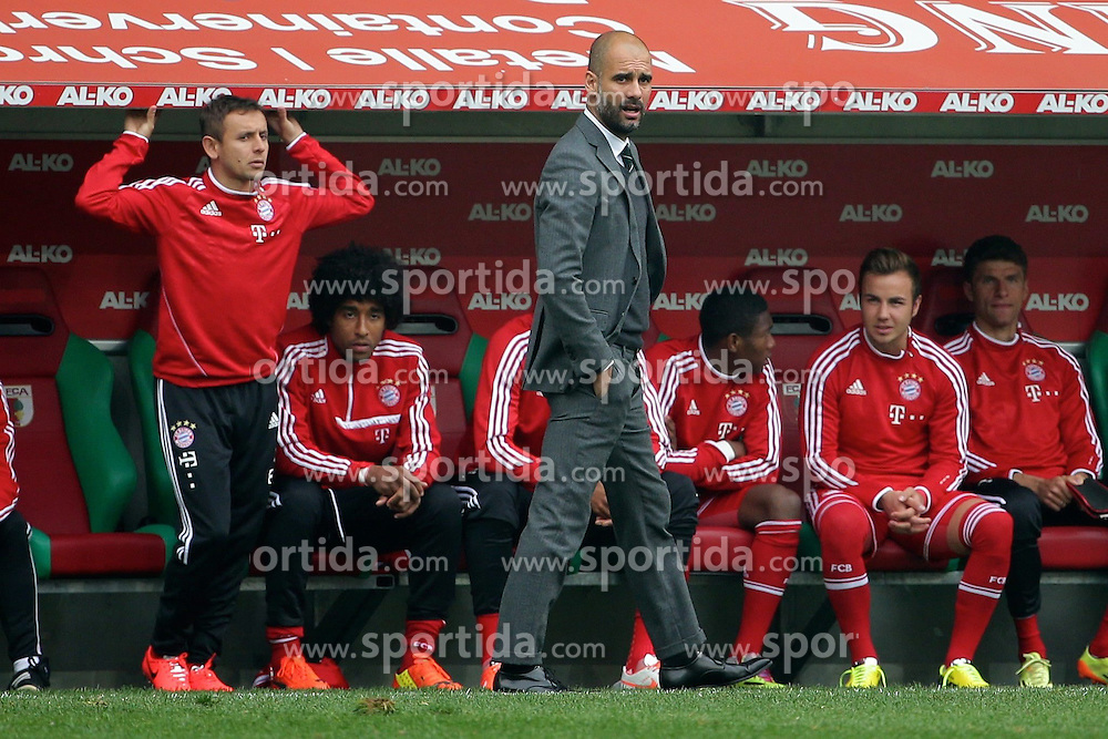 05.04.2014, SGL Arena, Augsburg, GER, 1. FBL, FC Augsburg vs FC Bayern Muenchen, 29. Runde, im Bild Trainer Josep Guardiola (Bayern Muenchen) sauer // during the German Bundesliga 29th round match between FC Augsburg and FC Bayern Munich at the SGL Arena in Augsburg, Germany on 2014/04/05. EXPA Pictures &copy; 2014, PhotoCredit: EXPA/ Eibner-Pressefoto/ Fastl<br /> <br /> *****ATTENTION - OUT of GER*****
