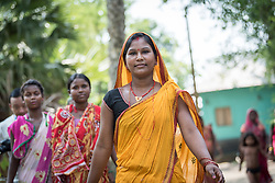 16 September 2018, Sohal Tole, Jahada rural municipality, Nepal: Women walk through Sohal Tole. Sohal Tole is a community inhabited by Santal and Dalit (Musahar) people, who find themselves as the very margin of society in Nepal. The 54 households are supported by the Nepal Evangelical Lutheran Church, as they mobilize together on disaster preparedness, income generating activities, financial governance, and mobilization on sanitation, education and entrepreneurship. The community project also receives technical support from the Lutheran World Federation World Service programme.