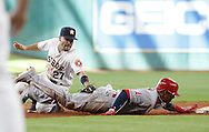 Jun 22, 2016; Houston, TX, USA; Los Angeles Angels third baseman Yunel Escobar (6) is tagged out at second base by Houston Astros designated hitter Jose Altuve (27) in the ninth inning at Minute Maid Park. Astros won 3 to 2. Mandatory Credit: Thomas B. Shea-USA TODAY Sports