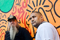 2 August, 2008. New York, NY. Angel Ortiz (right), 41, a graffiti artist who collaborated with Keith Haring in the 80's, is here in front of the mural he tagged on July 22nd 2008. Next to him, on the left, is Clayton Patterson, born in 1948, who helped Angel Ortiz with the graffiti. Angel Ortiz tagged his nickname &quot;LA2&quot;, which refers to &quot;Little Angel&quot;, on the Keith Haring mural that was reproduced on May 4th 2008, after the original 1982 graffiti was painted over. Angel Ortiz asked Clayton Patterson, an artist and gallerist, to help him tag the wall with his own artwork. Mr. Ortiz has accused the Haring Foundation of denying him credit on many of the jointly produced works.  The two artists met in 1980, when Angel Ortiz was 13 years old. Subsequently, Ortiz and Haring collaborated for several years and had joint shows. <br />  &copy;2008 Gianni Cipriano for The New York Times<br /> cell. +1 646 465 2168 (USA)<br /> cell. +1 328 567 7923 (Italy)<br /> gianni@giannicipriano.com<br /> www.giannicipriano.com