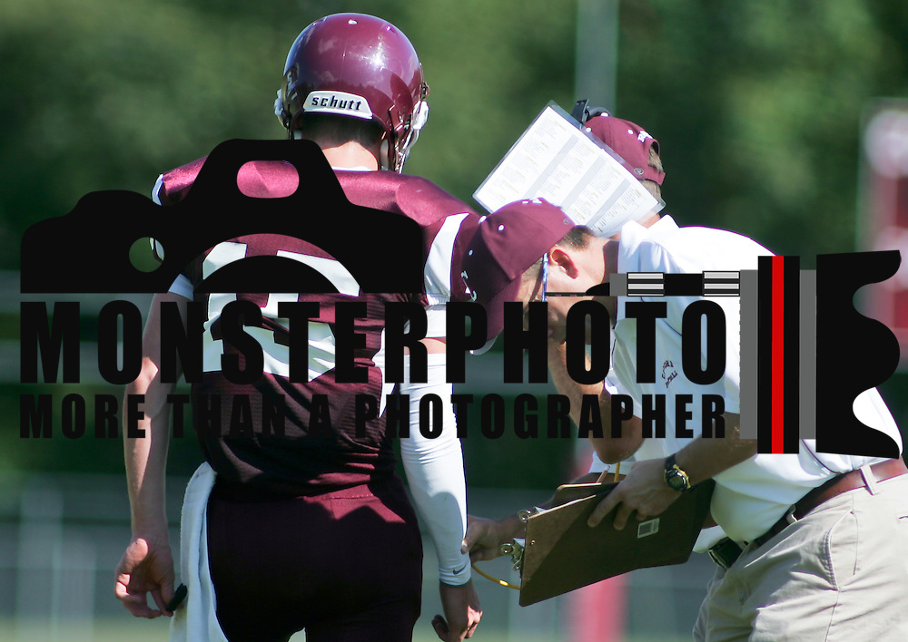9/17/10 Wilmington DE: Concord QB (#15) Jeffrey Paige getting instructions from coaches during the game at Concord High School in Wilmington Delaware. The Caesar Rodney Riders defeated The Concord Raiders 46-29. Special to The News Journal/SAQUAN STIMPSON