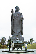 The Ushiku Amida Buddha statue stands in a place called Ushiku Arcadia (formely Jodo Teien Garden) in Ibaraki Prefecture about 50 kilometres northeast of Tokyo. At 100 metres tall from head to toes and standing on a 10 metre high lotus base and another 10 metre platform the total height of the statue is 120 metres making it the tallest Buddhist statue in the World. Japan. February 2005