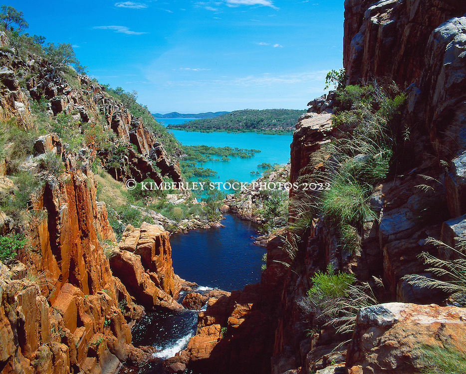 A small waterfall flows into West Talbot Bay on the Kimberley coast.