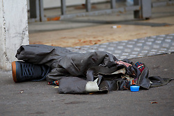 © Licensed to London News Pictures. 16/11/2015. Paris, France. A victims clothes left outside Bataclan Cafe in Paris, France following the Paris terror attacks on Monday, 16 November 2015. Photo credit: Tolga Akmen/LNP