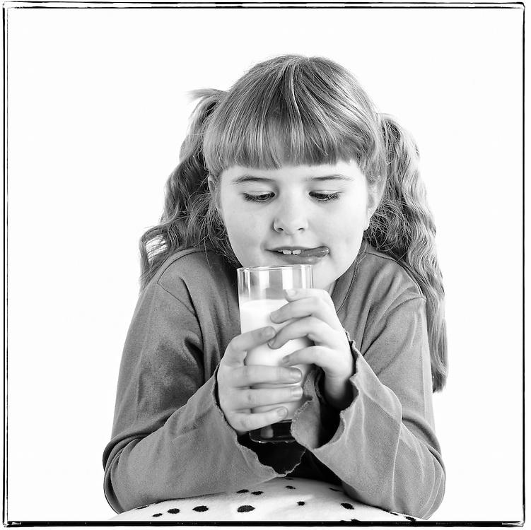Little girl enjoying her fresh glass of milk