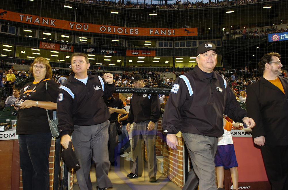 28 September 2007:  Umpires Greg Gibson (L) and Dana DeMuth (R) take the field prior to the game between the New York Yankees and the Baltimore Orioles.  The Orioles defeated the Yankees 10-9 in ten innings at Camden Yards in Baltimore, MD.  ****For Editorial Use Only****