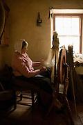 Woman spinning wool, Ulster Folk Park, Northern Ireland, UK
