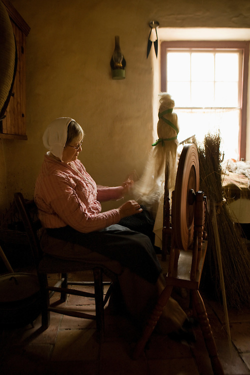 Woman spinning wool, Ulster Folk Park, Northern Ireland, UK