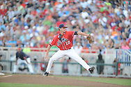 Mississippi's Chris Ellis (10) vs. Virginia in the College World Series in Omaha, Neb. on Sunday, June 15, 2014. Virginia won 2-1.