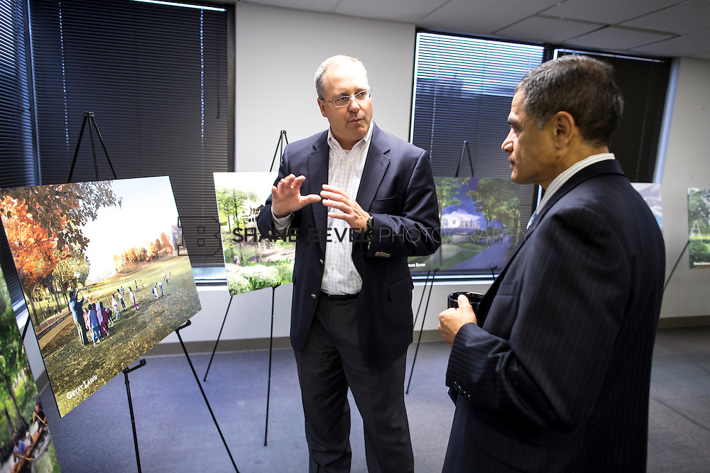 9/15/14 8:40:40 AM -- Victor Mendez - Deputy Secretary of Transportation meets with Jeff Stava and Mayor Dewey Bartlett regarding TIGER grant funding for improvements to Riverside Drive in cooperation with The Gathering Place for Tulsa. <br /> <br /> Photo by Shane Bevel
